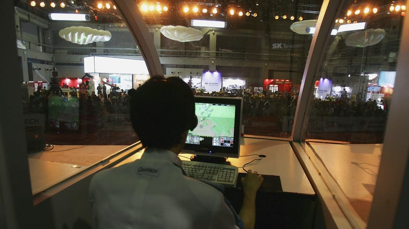 A gamer playing 'Warcraft III' at the Korea Cyber Game 2005 in Beijing, China.