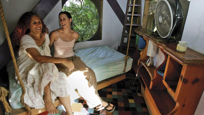 Shawnee Chasser, left, and daughter Wren Levy share a laugh while posing in a bedroom in Chasser's treehouse Sunday, Aug. 5, 2007, in Miami. Photo via AP.