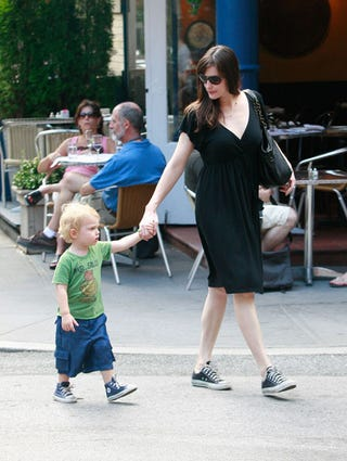 Illustration for article titled Liv Tyler And Son Milo Both Wear Comfy Converse Sneakers