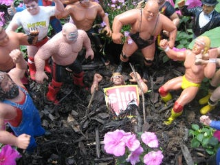 Illustration for article titled There Was A Poignant, Action Figure-Only Funeral For The Macho Man In A Backyard This Weekend