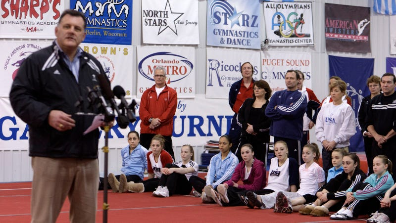 Steve Penny, president of USA Gymnastics, speaking before parents, gymnasts and guests/Image via Getty.