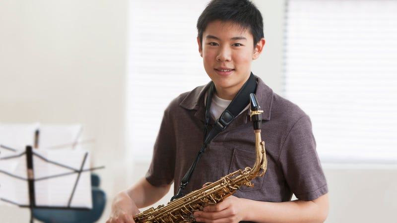 Illustration for article titled Disloyal Piece Of Shit: This Middle Schooler Casually Switched From Playing The Clarinet To The Alto Saxophone, So He'll Almost Certainly Cheat On His Wife Someday