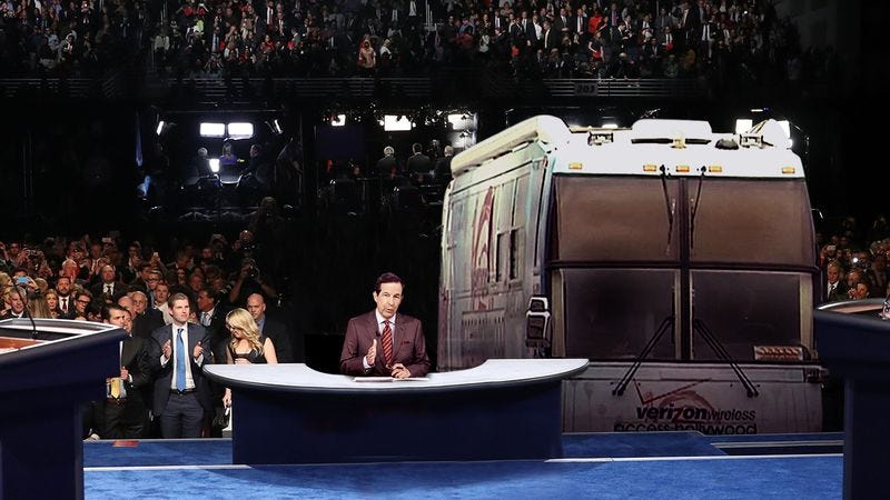 Illustration for article titled Punching Back: Hillary Clinton Invited The 'Access Hollywood' Bus To Sit In The Front Row Of The Debate