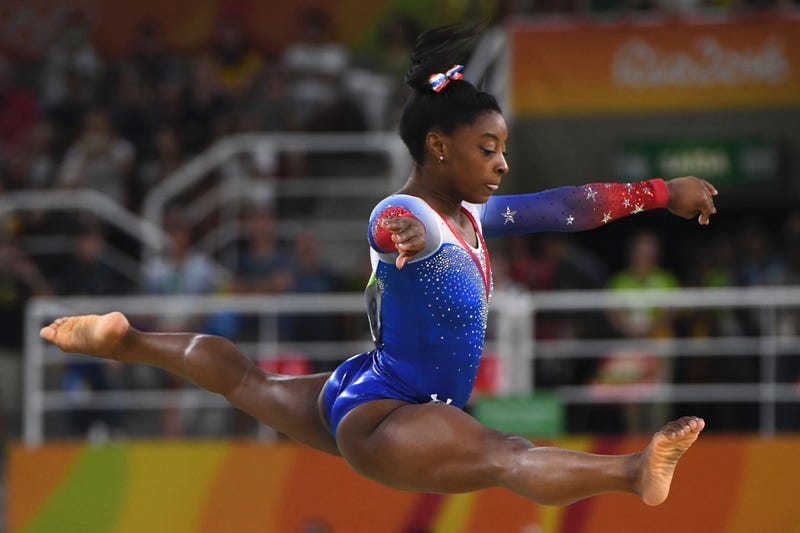 Simone Biles competes in the women's floor event final of the Artistic Gymnastics during the Rio Olympic Games in Rio de Janeiro on Aug. 16, 2016. TOSHIFUMI KITAMURA/AFP/Getty Images