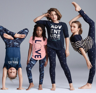 """Ava, 8, Lucy, 8, Fanny, 12, and Angelina, 12—known collectively as Le Petit Cirque, """"the only all-kid humanitarian cirque company in the world""""—are the new faces of Gap's GapKids x ED lifestyle brand, comfortable cottonwear for active girls.GapKids x ED via Twitter"""