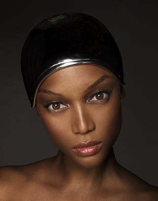 Illustration for article titled Smiling With Eyes + Metal Swim Cap - Weave = Another Tyra 'ANTM' Promo Shot