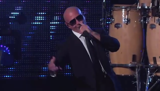 Illustration for article titled Pitbull Performs on Kimmel, Remains Greatest Man on Earth