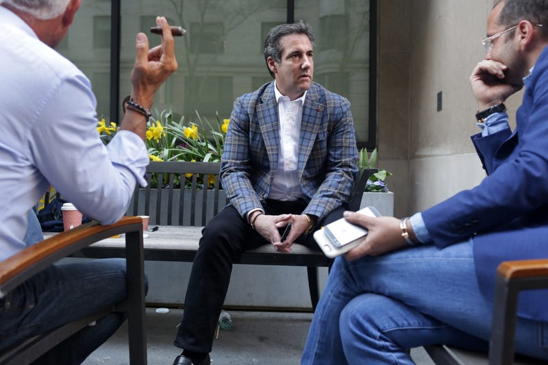 Michael Cohen, center, President Donald Trump's personal attorney, chats with friends, including Rotem Rosen, (in glasses), near the Loews Regency hotel on Park Ave on April 13, 2018 in New York City.