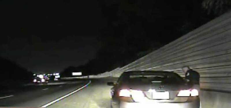 Cobb County, Ga., Police Lt. Greg Abbott was caught on police dashcam footage reassuring a white woman that she wouldn't be shot because she's not black. (WSBTV screenshot)