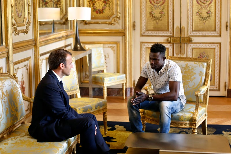 French President Emmanuel Macron meets with Mamoudou Gassama, 22, from Mali, at the presidential Elysee Palace in Paris on May, 28, 2018.