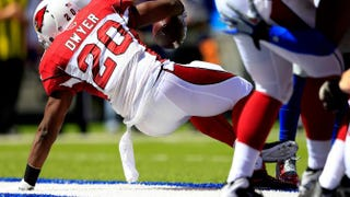 Running back Jonathan Dwyer, No. 20 of the Arizona Cardinals, scores a touchdown in the first quarter against the New York Giants during a game at MetLife Stadium Sept. 14, 2014, in East Rutherford, N.J.Alex Trautwig/Getty Images