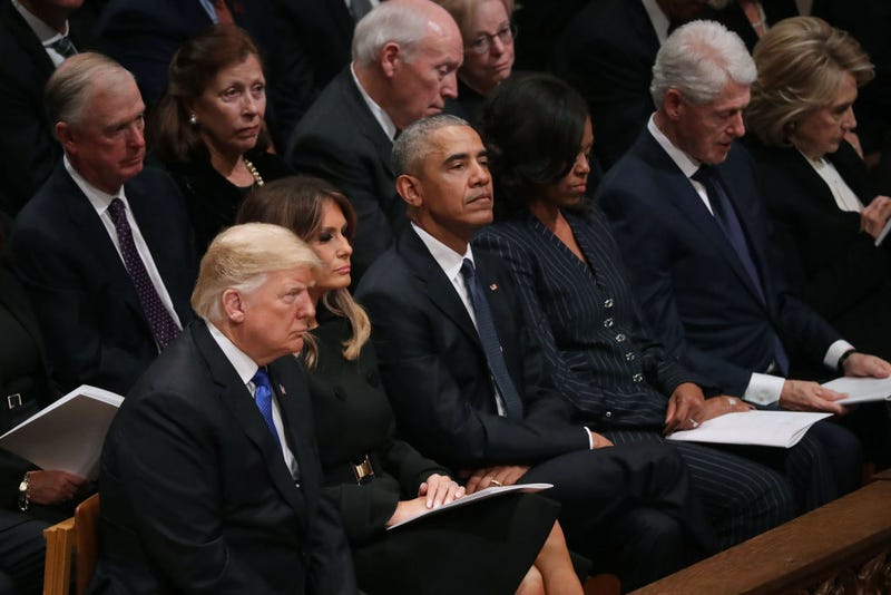 Illustration for article titled Y'all's Triflin'-Ass President Can't Even Sit Up Straight During a Funeral
