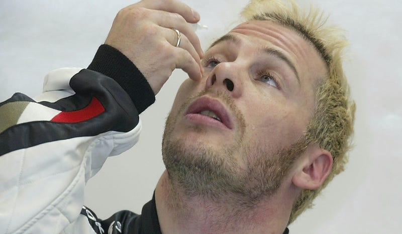One of Jacques Villeneuve's more successful post-championship moments: putting in an eyedrop. Photo credit: Mark Thompson/Getty Images