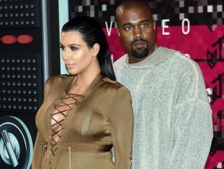 Kim Kardashian and Kanye West arrive on the red carpet at the MTV Video Music Awards, Aug. 30, 2015, at the Microsoft Theater in Los Angeles.MARK RALSTON/AFP/Getty Images