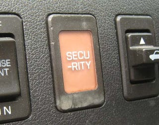 Illustration for article titled Back When Automotive Interior Designers Weren't So Slick: SECU- RITY Indicator Lamp