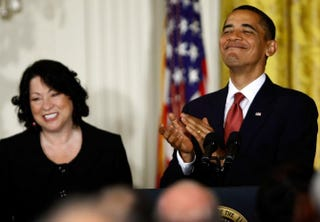 President Barack Obama (right) applauds newly appointed Supreme Court Justice Sonia Sotomayor during a reception in her honor at the White House Aug. 12, 2009, in Washington, D.C.Win McNamee/Getty Images