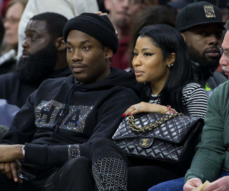 Musical artists Meek Mill and Nicki Minaj watch the game between the Golden State Warriors and Philadelphia 76ers on Jan. 30, 2016, at the Wells Fargo Center in Philadelphia.Mitchell Leff/Getty Images