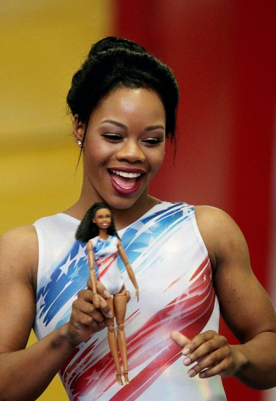 Olympic gymnast Gabrielle Douglas shows off her Gabrielle Douglas Barbie doll.Barbie