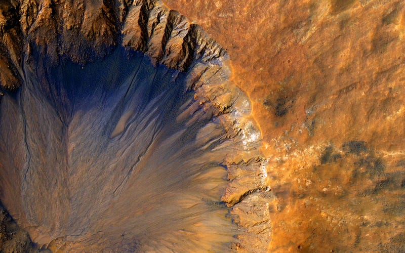 """Illustration for article titled A Crater on Mars That's Only """"New"""" in a Cosmic Sense"""