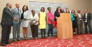 NABJ President Sarah J. Glover, at lectern, with the association's new board of directors after the August electionGabriella Angotti-Jones/NABJ Monitor