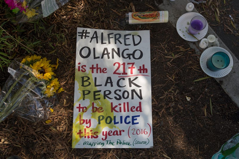 A sign lies on the ground at the site where an unarmed black man, Alfred Olango, 38, had been shot by police earlier that week on Sept. 29, 2016, in El Cajon, Calif.