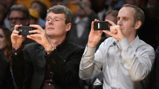 Illustration for article titled Caption This Dumb Picture of RIM's CEO Taking a Picture with a BlackBerry 10 Device at a Basketball Game