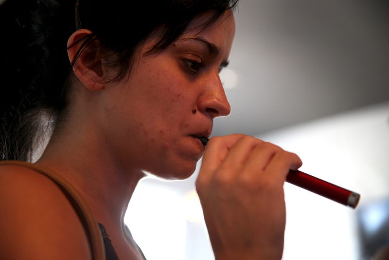 A customer purchases an e-cig at an electronic cigarette store in Miami in 2014 (Joe Raedle/Getty Images)