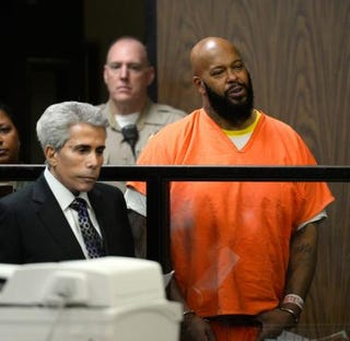 """Marion """"Suge"""" Knight (right) and his lawyer David E. Kenner appear at his arraignment at Compton Courthouse Feb. 3, 2015, in California.Paul Buck-Pool/Getty Images"""