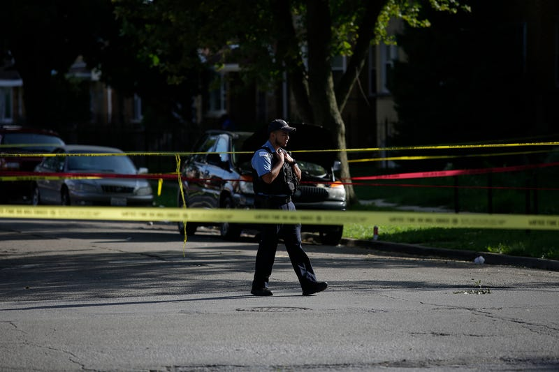 A Chicago police officer stands at the crime scene of a fatal shooting where a man was shot in the head in the 7300 block of South Rockwell Street on Aug. 31, 2016, in Chicago. Joshua Lott/Getty Images