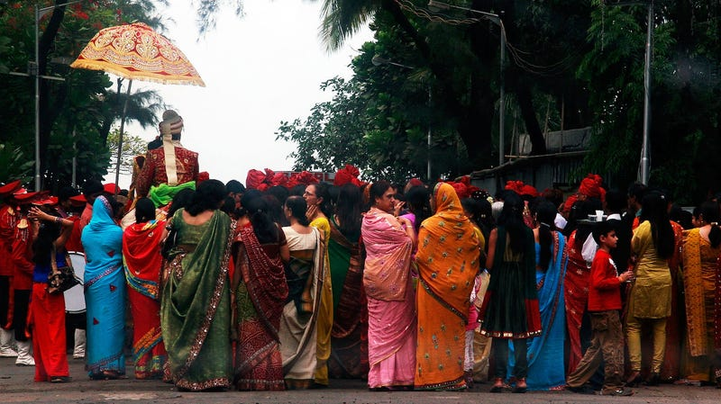 A wedding procession takes place a few hundred meters away from the Dadar Crematorium on November 30, 2008 in Mumbai (Bombay), India.
