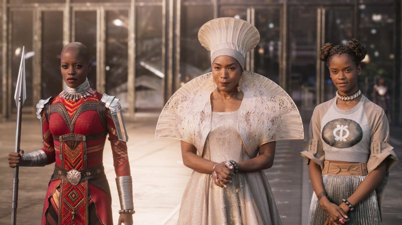 Florence Kasumba as Ayo, Angela Bassett as Queen Ramonda, and Letitia Wright as Princess Shuri in Black Panther