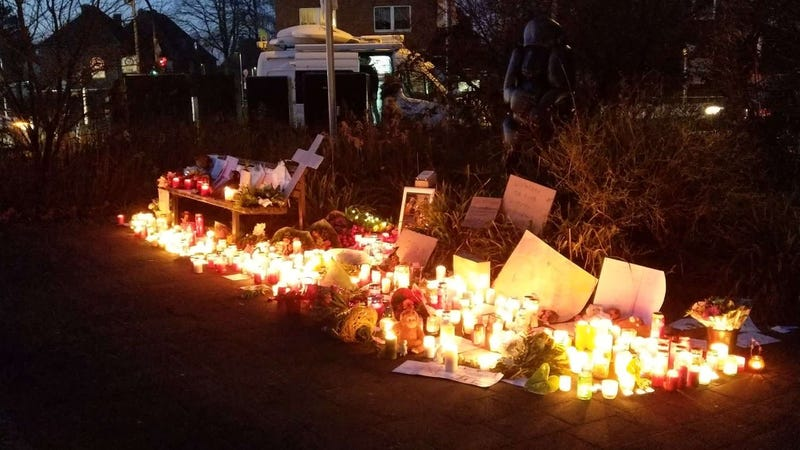 Candles, photos, and other items left by well-wishers outside the Krefeld zoo.