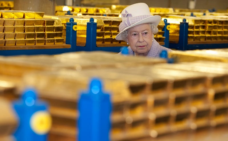 Queen Elizabeth inspecting stacks of gold at the Bank of England, which doesn't actually have anything to do with Canadian currency, but is just kind of funny to look at (Photo by Eddie Mulholland - WPA Pool/Getty Images)