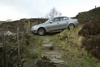 Illustration for article titled British BMW Driver Follows Sat Nav To Cliff Edge, Darwin Loses