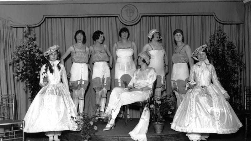 A group of models in a corset parade at Dorothy Perkins store on Oxford Street, London, 1925. Image via Getty.