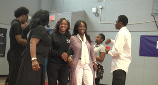 A'Ja Booth and Nadirah Muhammad walk arm in arm at the school's celebration.Detroit Public Schools
