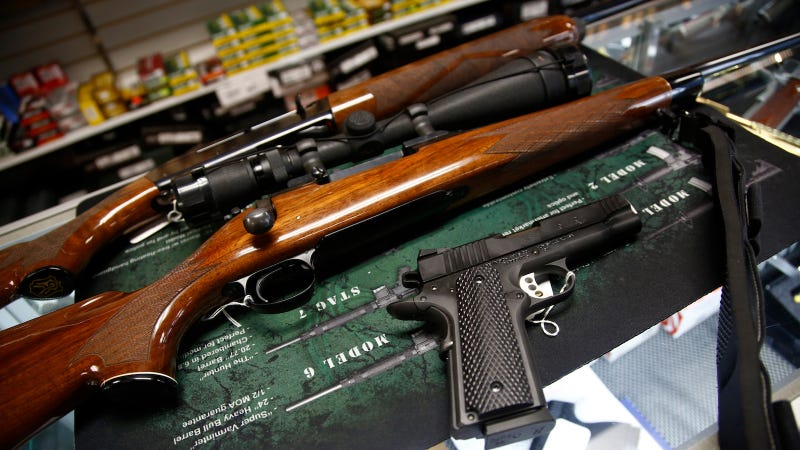 A Remington 700 hunting rifle, a Remington 1100 shotgun and a Remington R1 Enhanced model 1911 pistol are seen for sale at Atlantic Outdoors gun shop on March 26, 2018 in Stokesdale, North Carolina