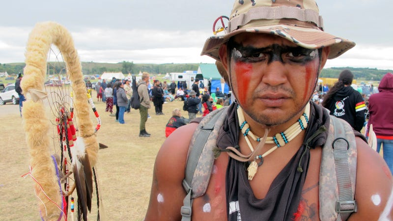 Jon Don Ilone Reed, an Army veteran and member of South Dakota's Cheyenne River Sioux Tribe, at a protest near the Standing Rock Sioux reservation in North Dakota. Image via AP.