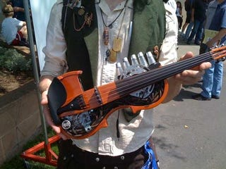 Illustration for article titled Modded Violin adds Steampunk-esque Styling, One Extra String