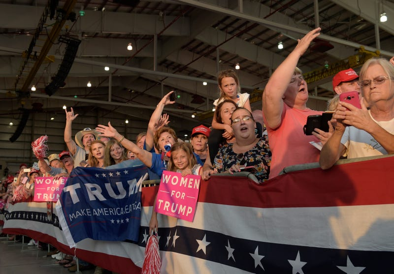 People wait for the arrival of President Donald Trump at a rally in Melbourne, Fla., on Feb. 18, 2017. (Susan Walshl/AP Images)