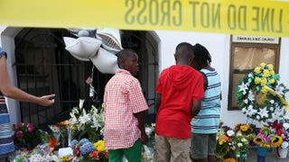 Children pay their respects in front of Emanuel African Methodist Episcopal Church in Charleston, S.C., June 18, 2015, after a mass shooting at the church that killed nine people.Joe Raedle/Getty Images