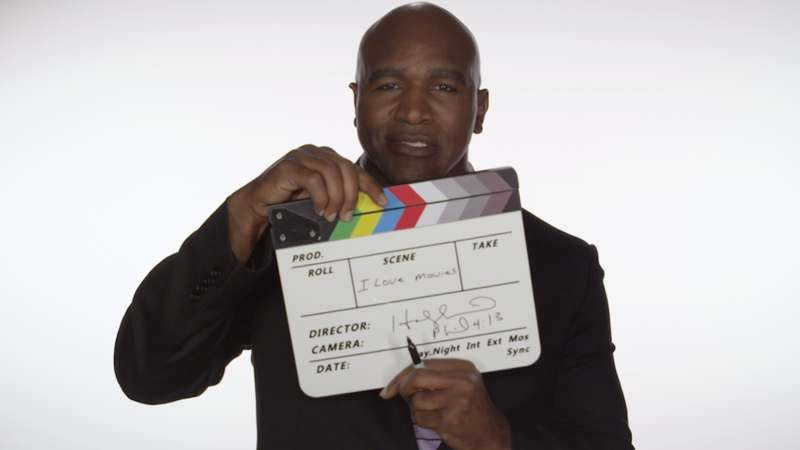 Evander Holyfield smiles warmly as he thinks of all the movies that are out there.