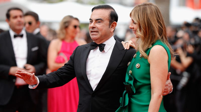 Carlos and Carole Ghosn, wearing outfits similar to the ones from their wedding party at the Palace of Versailles.