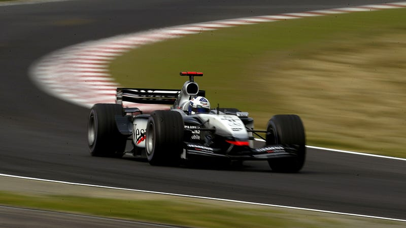 David Coulthard running Suzuka in 2003. I believe this is 130R. Look close and you'll see the dust on this slide film.