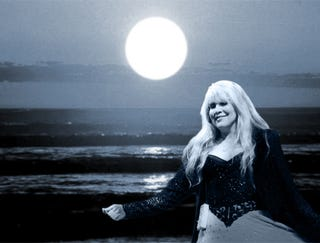 Illustration for article titled Stevie Nicks Dancing Alone On Beach Under Full Moon