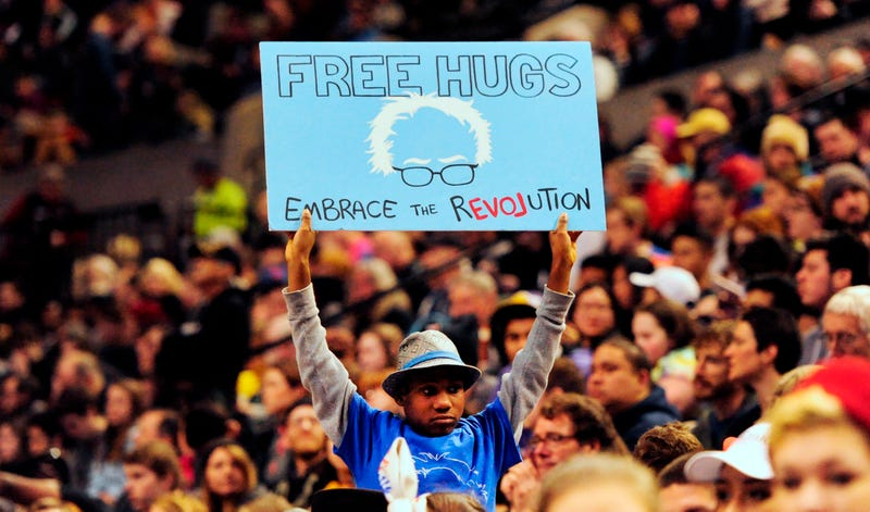This file photo taken March 25, 2016, shows Devonte Hart holding up a sign as Democratic presidential candidate Bernie Sanders addressed the crowd during a rally at the Moda Center in Portland, Ore.