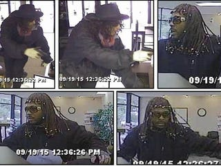 Image of two men, apparently disguised as Rick James and  Youngblood Priest, as authorities say they robbed an Indianapolis bank Sept. 19, 2015Indianapolis Metropolitan Police Department