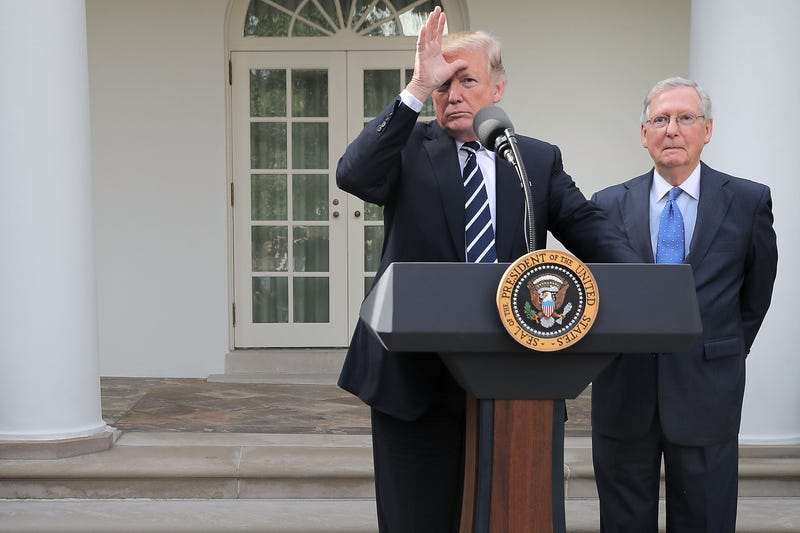 President Donald Trump and Senate Majority Leader Mitch McConnell in the Rose Garden following a lunch meeting at the White House in Washington, D.C., on Oct. 16, 2017