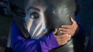 Fans comfort each other while visiting a memorial outside Paisley Park, the home and studio of Prince, on April 22, 2016, in Chanhassen, Minn. Prince, 57, was pronounced dead shortly after being found unresponsive April 21, 2016, at Paisley Park.Scott Olson/Getty Images