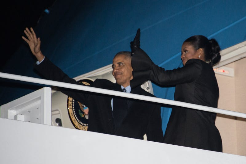 President Barack Obama and first lady Michelle Obama wave before boarding Air Force One at Andrews Air Force Base in Maryland on Dec. 16, 2016, as they depart for their Christmas holiday in Hawaii.NICHOLAS KAMM/AFP/Getty Images